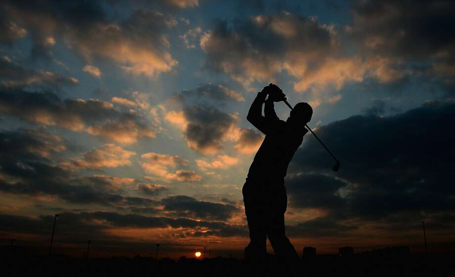Irish swing:Rory McIlroy practices on the driving range ahead of the first round of the Abu Dhabi HSBC Golf Championship. Photo: Ross Kinnaird, Getty Images