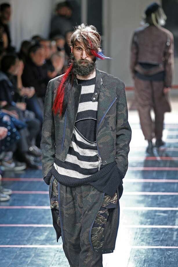 Clothes that say 'I am a hobo': Yohji Yamamoto's designs for the men's Fall-Winter 2014-2015 collection in Paris include a camo outfit that's perfect for picking up some spare change. Photo: Remy De La Mauviniere, Associated Press