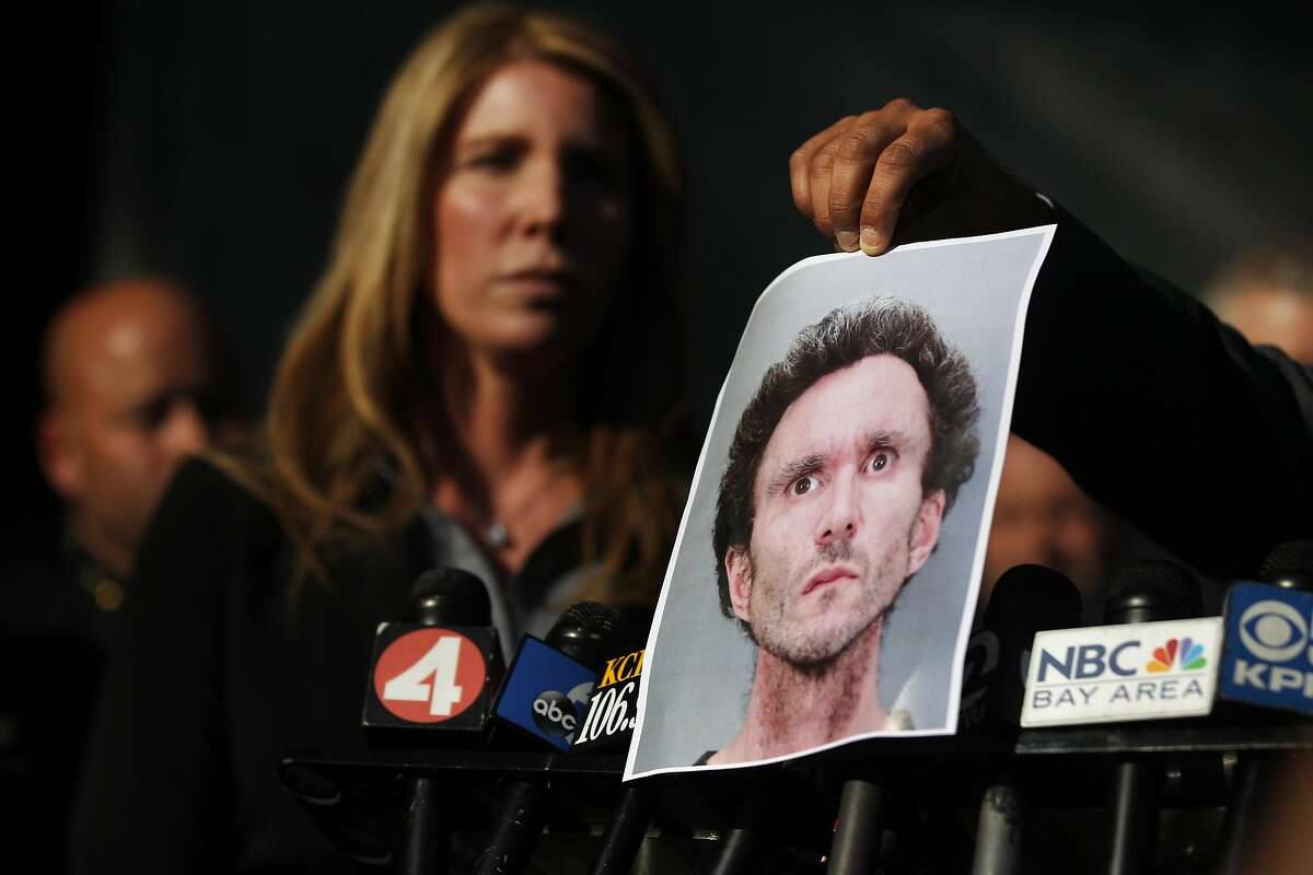 A photograph of Patrick William Brennan is shown to the media during a press conference outside of the San Jose Police Department Jan. 16, 2014 in San Jose. On Thursday police identified Patrick William Brennan as the main suspect responsible for a dozen blazes that have broken out in the area since Jan. 7. He was taken into custody Wednesday evening by San Jose investigators.