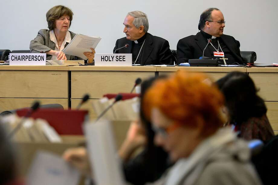 Panel Chairwoman Kirsten Sandberg (left) and Vatican officials Silvano Tomasi and Charles Scicluna. Photo: Fabrice Coffrini, AFP/Getty Images