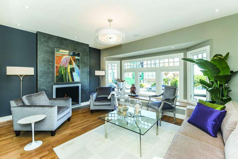 A Bay Window With Sitting Bench And Gas Fireplace With