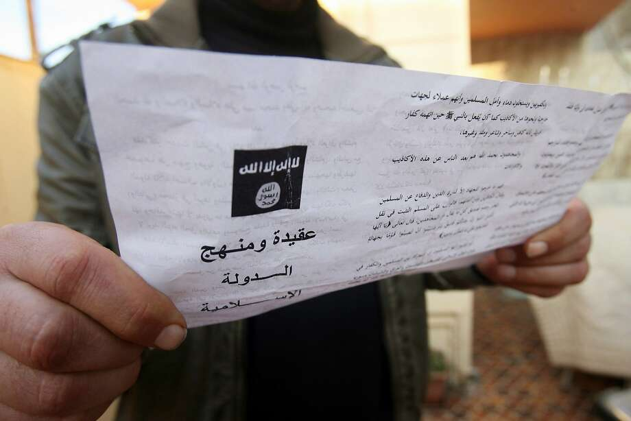 A man reads a pamphlet issued by al Qaeda-linked militants, urging residents in the western city of Fallujah to join them in their weeks-long fight against Iraqi troops. Photo: Str, Associated Press