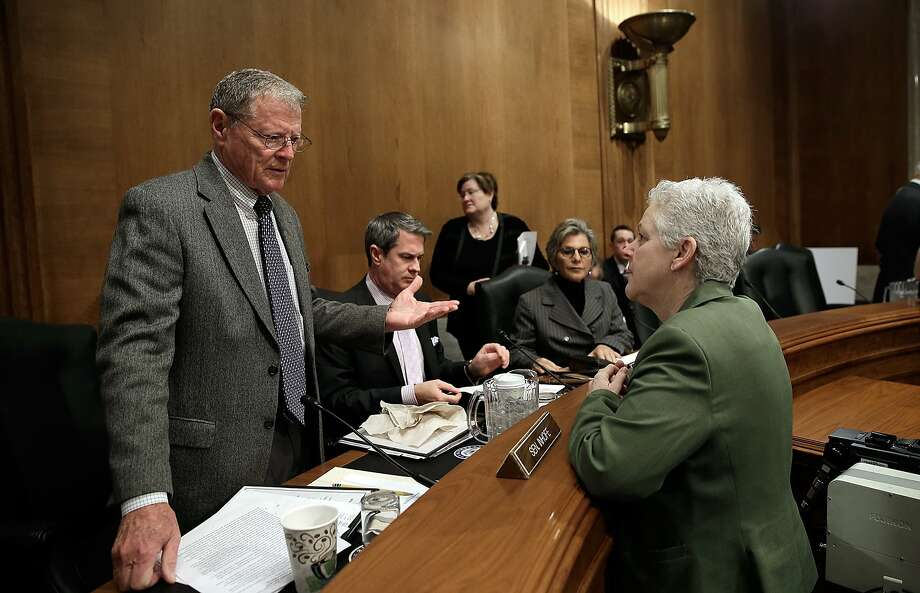 Environmental Protection Agency Administrator Gina McCarthy (right) confers with Sen. James Inhofe, R-Okla., before a hearing on a climate plan began. Photo: Win McNamee, Getty Images
