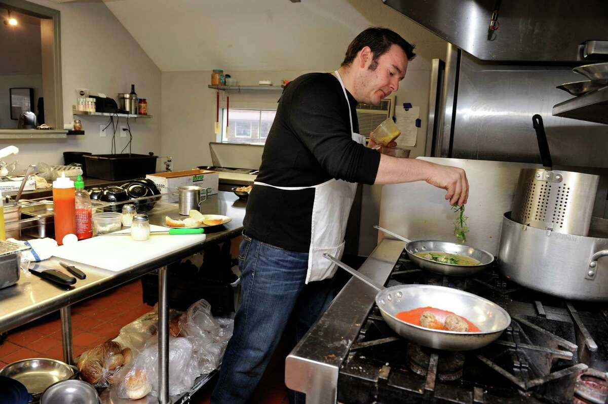 Rob Atkinson, owner of Mima's Meatballs & More on Mill Plain Road in Danbury, Conn., prepares Italian Wedding Soup for a customer Thursday, January 16, 2014.