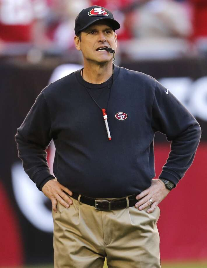 San Francisco 49ers head coach Jim Harbaugh as the team takes on the  Arizona Cardinals in December.  Pleats add unnecessary volume, making the wearer look bigger than they really are. Tucking in a sweatshirt doesn't help. Photo: Matt York, Associated Press