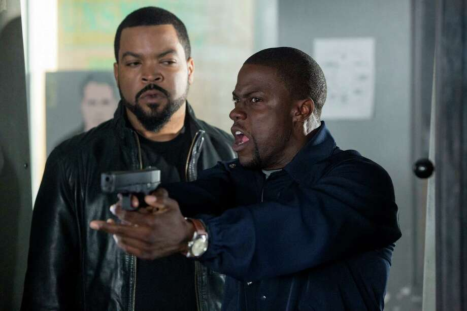 "This image released by Universal Pictures shows Ice Cube, left, and Kevin Hart in a scene from ""Ride Along."" (AP Photo/Universal Pictures, Quantrell D. Colbert) ORG XMIT: NYET515 Photo: Quantrell D. Colbert / Universal Pictures"