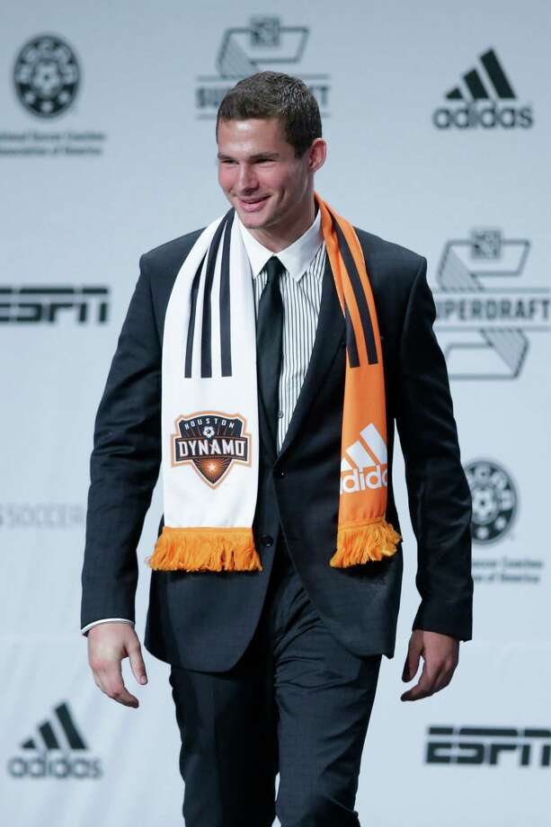 A.J. Cochran walks on stage after being selected by the Houston Dynamo in the first round of the 2014 Major League Soccer SuperDraft, Thursday, Jan. 16, 2014, in Philadelphia. (AP Photo/Matt Rourke) Photo: Matt Rourke, Associated Press / AP