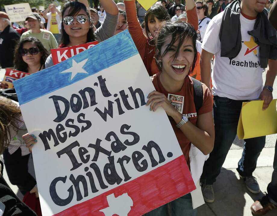 Teachers, students, parents and school administrators take part in a rally for Texas public schools at the state Capitol last year. Photo: Associated Press File Photo / AP