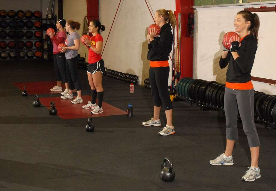 Early risers work out at the 6 a.m. class at Crossfit at their facility on Telephone Rd. Thursday Dec. 04, 2008. (Dave Rossman for the Chronicle) Photo: Dave Rossman, For The Chronicle