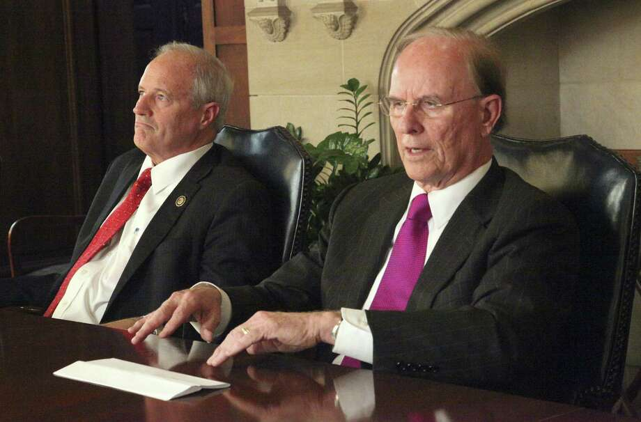 County Judge Nelson Wolff (right) and his Democratic re-election opponent, Precinct 4 Commissioner Tommy Adkisson, are now on opposite sides of the streercar issue. Photo: Juanito Garza / San Antonio Express-News / San Antonio Express-News
