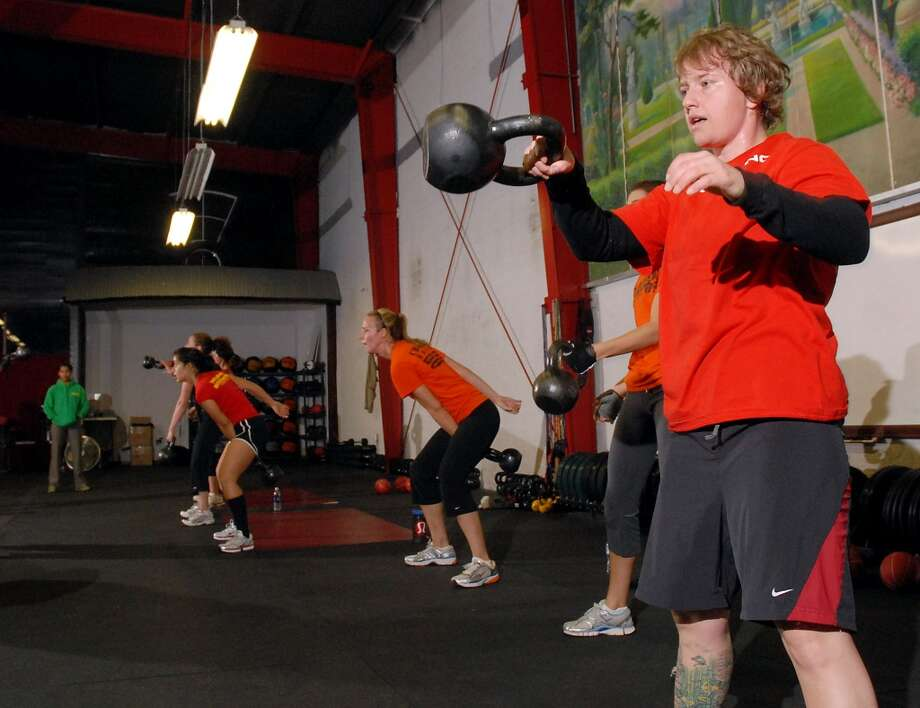 Adrian Sanders works out at the 6 a.m. class at Crossfit at their facility on Telephone Rd. Thursday Dec. 04, 2008. (Dave Rossman for the Chronicle) Photo: Dave Rossman, For The Chronicle