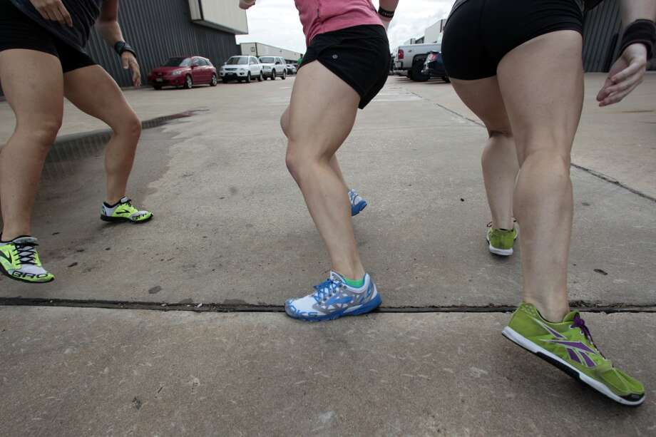 (l-r) Jamie Carter, Janet Black, and Beth Spearman run sprints at Atomic CrossFit in Stafford,Texas, Wednesday, July 17, 2013. The group are all part of a team of six members training forthe Crossfit Games in Carson California that begin July 24. The team is comprised of 3 men and 3 women Beth Spearman, Janet Black, Jamie Carter, Daniel Ward ,Will Maloy, and Benjamin Bacon. ( Billy Smith II / Chronicle ) Photo: Billy Smith II, Chronicle