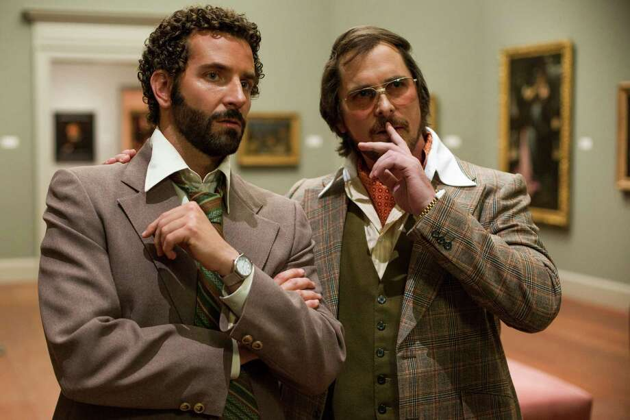 "In this film image released by Sony Pictures, Bradley Cooper, left, as Richie Dimaso and Christian Bale as Irving Rosenfeld talk in a gallery at the Frick Museum in a scene from Columbia Pictures'  ""American Hustle."" After meeting the dapper Rosenfeld and his seductive partner, Sydney Prosser (Amy Adams), Cooper's character, Dimaso, ups his fashion game. (AP Photo/Sony - Columbia Pictures, Francois Duhamel) ORG XMIT: CAET554 Photo: Francois Duhamel / Sony Pictures"