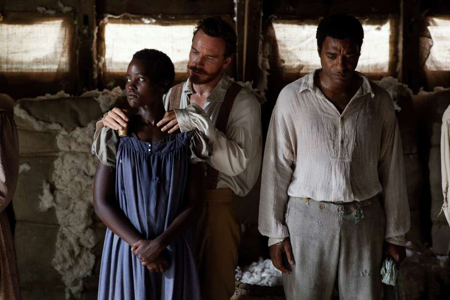 "This image released by Fox Searchlight shows Lupita Nyong'o, from left, Michael Fassbender and Chiwetel Ejiofor in a scene from ""12 Years A Slave."" Fassbender was nominated for a Golden Globe for best supporting actor in a motion picture, Nyong'o was nominated for best supporting actress in a motion picture and Ejiofor was nominated for best actor in a motion picture drama for their roles in the film on Thursday, Dec. 12, 2013.  The film was also nominated for best drama. The 71st annual Golden Globes will air on Sunday, Jan. 12. (AP Photo/Fox Searchlight, Francois Duhamel) ORG XMIT: NYET768 Photo: Francois Duhamel / Fox Searchlight"