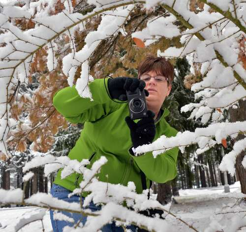 Debbie LeBaron of Schuylerville takes photographs of newly fallen snow as she leads her Saratoga Bridges photo club members through Saratoga Spa State Park Thursday Jan. 16, 2014, in Saratoga Springs, NY.  (John Carl D'Annibale / Times Union) Photo: John Carl D'Annibale / 00025401A