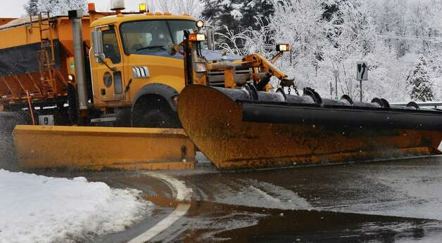 A NYS DPW plow clears Rt 50 Thursday Jan. 16, 2014, in Saratoga Springs, NY.  (John Carl D'Annibale / Times Union) Photo: John Carl D'Annibale / 00025401A