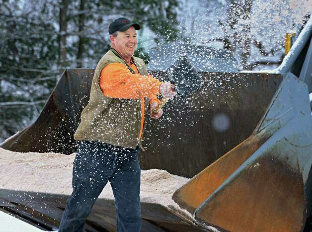 Saratoga County DPW worker Joe Button spreads road salt over the parking lot of the Saratoga County Animal Shelter Thursday Jan. 16, 2014, in Ballston Spa, NY.  (John Carl D'Annibale / Times Union) Photo: John Carl D'Annibale / 00025401A