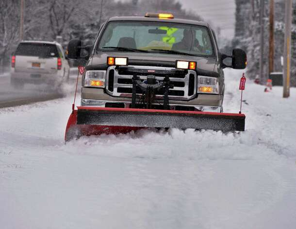 A town DPW truck plows sidewalks along Vischer Ferry Road Thursday Jan. 16, 2014, in Clifton Park, NY.  (John Carl D'Annibale / Times Union) Photo: John Carl D'Annibale / 00025401A