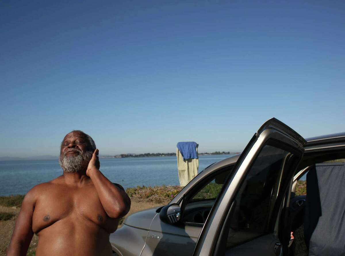 With record high temperatures reaching the Bay Area, Melvin Grant, 64, soaks in the sun in January 2014 at Emery Point in Emeryville.