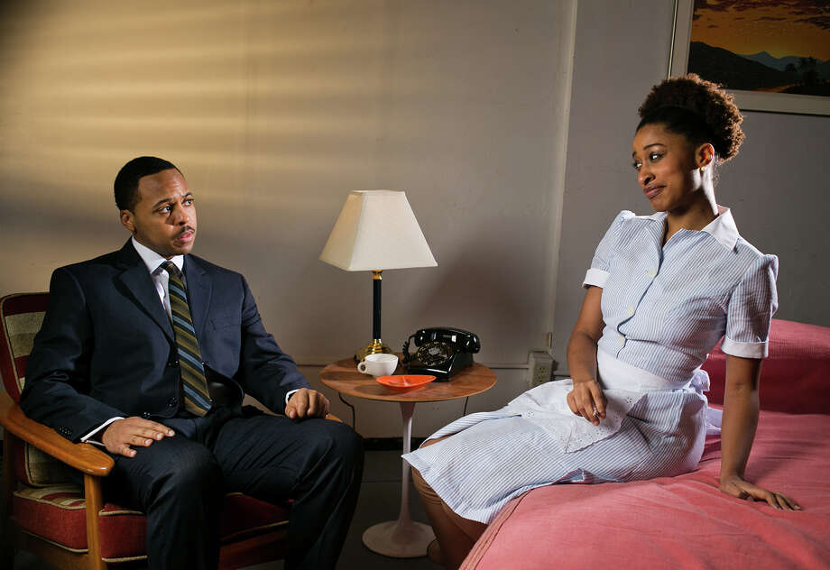 "Brandon Jones and Liz Morgan portray Martin Luther King Jr. and Lorraine Motel maid Camae in Capital Repertory Theatre's production of ""The Mountaintop,"" Jan. 17- Feb. 9, 2014, at Capital Repertory Theatre, 111 North Pearl Street, Albany. (Joe Schuyler) Photo: Joseph Schuyler / © Joseph Schuyler"