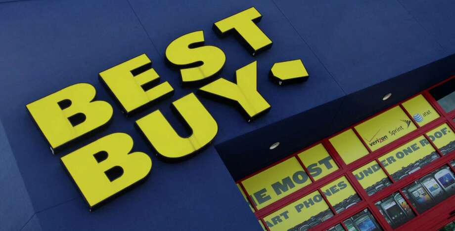 FILE - The Best Buy logo is displayed on a store in Miami, Fla. Best Buy said Thursday Jan. 16, 2014 that a key sales barometer fell during the holiday shopping season, stung partly by weakness in the U.S. and a highly promotional retail environment. Its stock dropped more than 13 percent in premarket trading. (AP Photo/J Pat Carter, File) ORG XMIT: NY116 Photo: J Pat Carter / AP