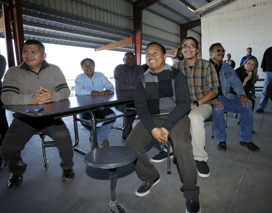 Florida farmworkers react after Walmart joins their initiative requiring tomato suppliers to increase pay and protect workers. Photo: Wilfredo Lee, Associated Press
