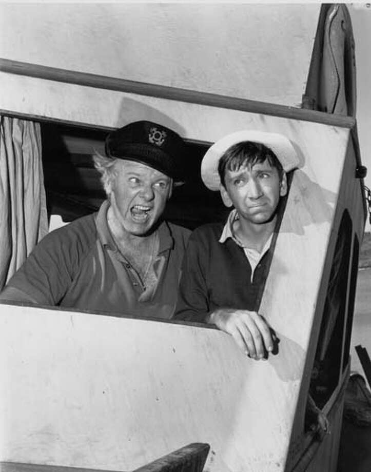 American actor Alan Hale Jr. (1921 - 1990) as The Skipper Jonas Grumby and American actor Bob Denver (1935 - 2005) as Gilligan appear in an episode of 'Gilligan's Island' in Los Angeles, California on November 21, 1963. Photo: CBS Photo Archive, Getty Images / 2008 CBS WORLDWIDE INC.