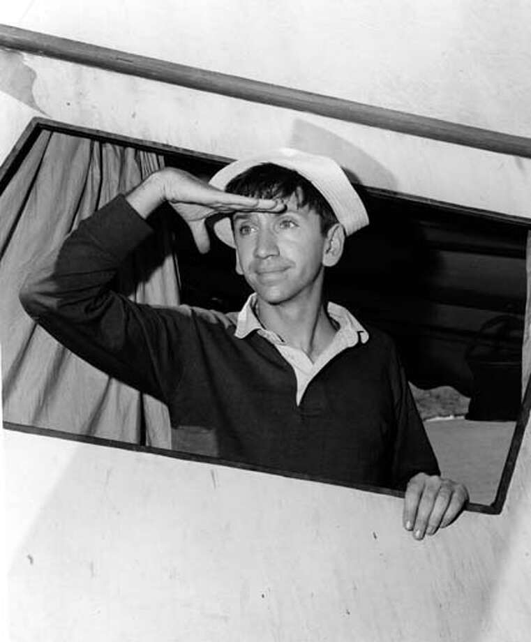 American actor Bob Denver (1935 - 2005) shields his eyes like a sailor looking into the distance as he poses in character as Gilligan the hapless first mate from the television situation comedy 'Gilligan's Island,' November 21, 1963. The show concerned the exploits and comic mishaps of a group of people who survived a shipwreck only to be stranded on a deserted island. Photo: CBS Photo Archive, Getty Images / 2005 CBS WORLDWIDE INC.