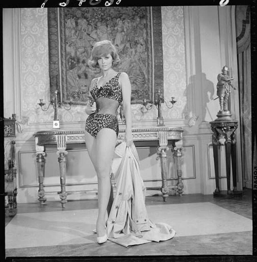 American actress Tina Louise (as Ginger Grant), dressed in leopard-print and fishnet swimwear, wields a revolver in a scene from an episode of the television comedy 'Gilligan's Island' entitled,'The Little Dictator' in Los Angeles, California on August 6, 1965. The episode was originally broadcast on September 30, 1965. Photo: CBS Photo Archive, Getty Images / 2008 CBS WORLDWIDE INC.