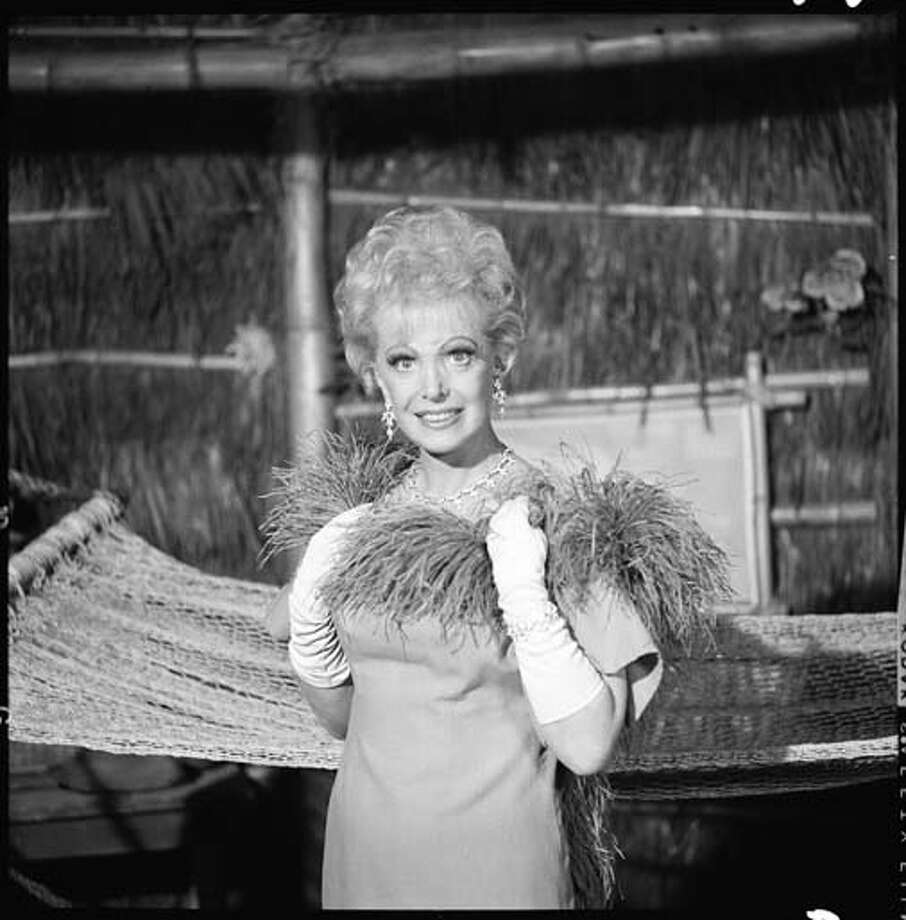 Portrait of American actress Natalie Schafer (1900 - 1991) (as Mrs. Howell) as she holds a feather boa at her neck in an episode of the television comedy 'Gilligan's Island' entitled 'Hair Today, Gone Tomorrow' on May 16, 1966. The episode was originally broadcast on October 31, 1966. Photo: CBS Photo Archive, Getty Images / 2008 CBS WORLDWIDE INC.