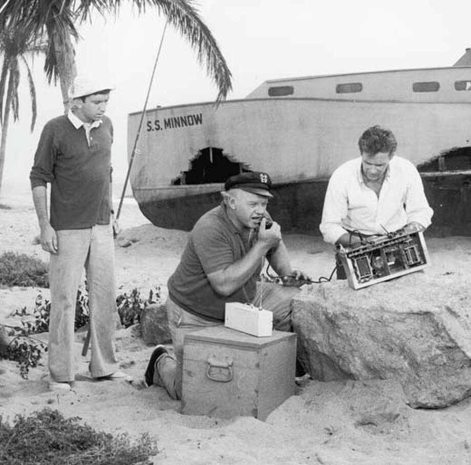 Circa 1966, American actors, left to right, Bob Denver, Alan Hale Jr. (1918-1990) and Russell Johnson attempt to use a homemade CB radio to contact civilization in a still from the television comedy show 'Gilligan's Island'. Photo: CBS Photo Archive, Getty Images / Archive Photos