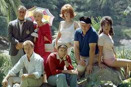 Portrait of the cast of 'Gilligan's Island,' in 1964. Pictured are (back row, from left) Jim Backus (1913 - 1989) as Thurston Howell III, Natalie Schafer (1900 - 1991) as Mrs. Howell, Tina Louise as Ginger Grant, Alan Hale Jr. (1918 - 1990) as the Skipper, and Dawn Wells as Mary Ann Summers; front row, from left, Russell Johnson (1924-2014) as the Professor and Bob Denver (1935-2005) as Gilligan.