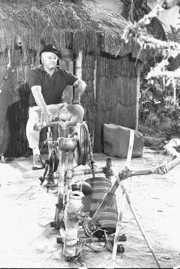 American actor Alan Hale Jr. (1921 - 1990), in character as the Skipper, rides a rickety bamboo contraption of some sort during the episode 'The Pigeon' of the CBS sitcom 'Gilligan's Island' in Studio City, California on February 6, 1967. Photo: CBS Photo Archive, Getty Images / 2007 CBS WORLDWIDE INC.