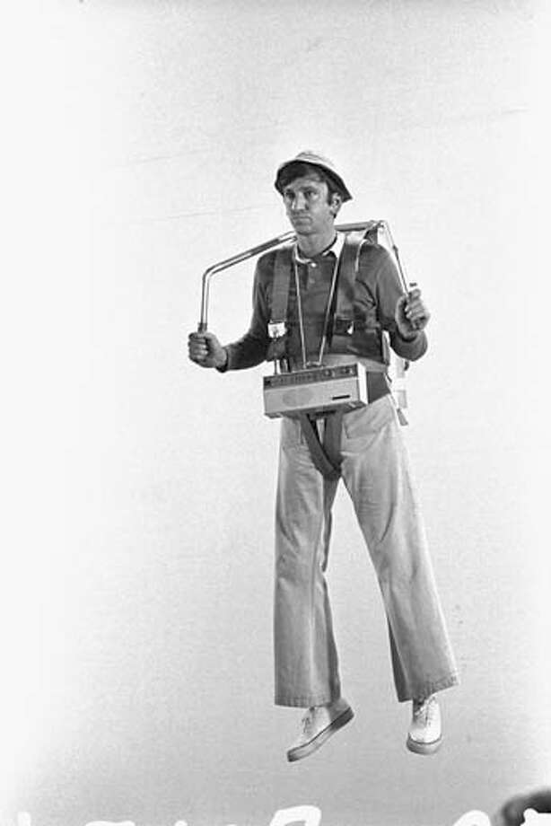 American actor Bob Denver (1935 - 2005) wears a harness and a fake jetpack during the episode 'The Pigeon' of the CBS sitcom 'Gilligan's Island' in Studio City, California on February 6, 1967. Photo: CBS Photo Archive, Getty Images / 2007 CBS WORLDWIDE INC.