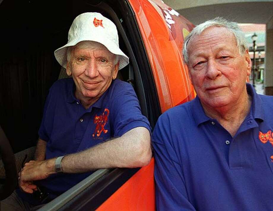 "Actors Bob Denver (1935-2005), left, who starred as ""Gilligan"" and Russell Johnson (1924-2014) who starred as ""The Professor"" on the television comedy 'Gilligan's Island' pose for a photograph during a reunion on November 12, 2000 in Miami. Photo: Tim Chapman, Getty Images / Hulton Archive"