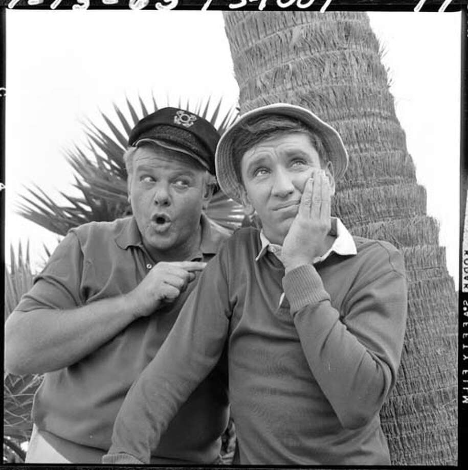 American actors Alan Hale Jr. (1918 - 1990) (left, as the Skipper) and Bob Denver (1935 - 2005) (as Gilligan) in a scene from an unidentified episode of the television comedy 'Gilligan's Island' on July 13, 1965. Photo: CBS Photo Archive, Getty Images / 2008 CBS WORLDWIDE INC.