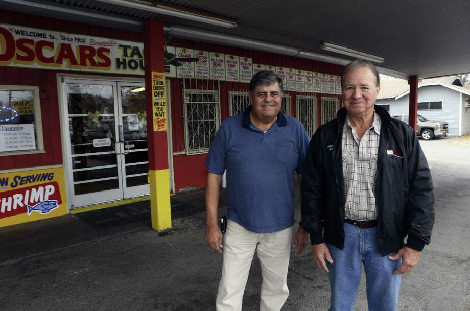 The late Oscar G. Garcia, the father of Rick (left) and Steve Garcia, opened an ice house in the early 1960s where youngsters bought sodas and hung out after school. A few years later, Oscar Garcia added on to the store and turned it into Oscar's Taco House. The kids who frequented the Taco House are now grandparents and great-grandparents and still loyal customers. Photo: Photos By Helen L. Montoya / San Antonio Express-News / SAN ANTONIO EXPRESS-NEWS