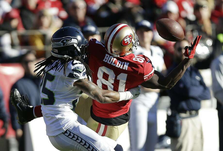 Seattle All-Pro cornerback Richard Sherman, shown defending 49ers wide receiver Anquan Boldin in December, is a leader on the NFL's No. 1 defense. Photo: Marcio Jose Sanchez, ASSOCIATED PRESS