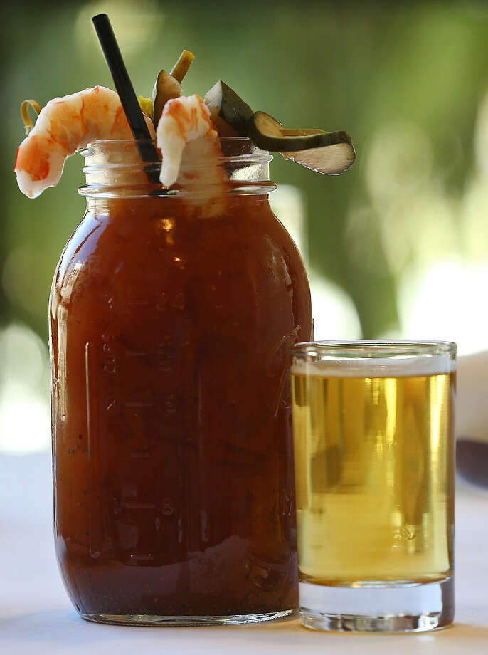The bloody mary at Lüke comes in a large mason jar with shrimp and veggies and a beer chaser. Photo: Jerry Lara / San Antonio Express-News / MAGS OUT; TV OUT; NO SALES; SAN ANTONIO OUT; AP MEMBERS ONLY; MANDATORY CREDIT; EFE OUT