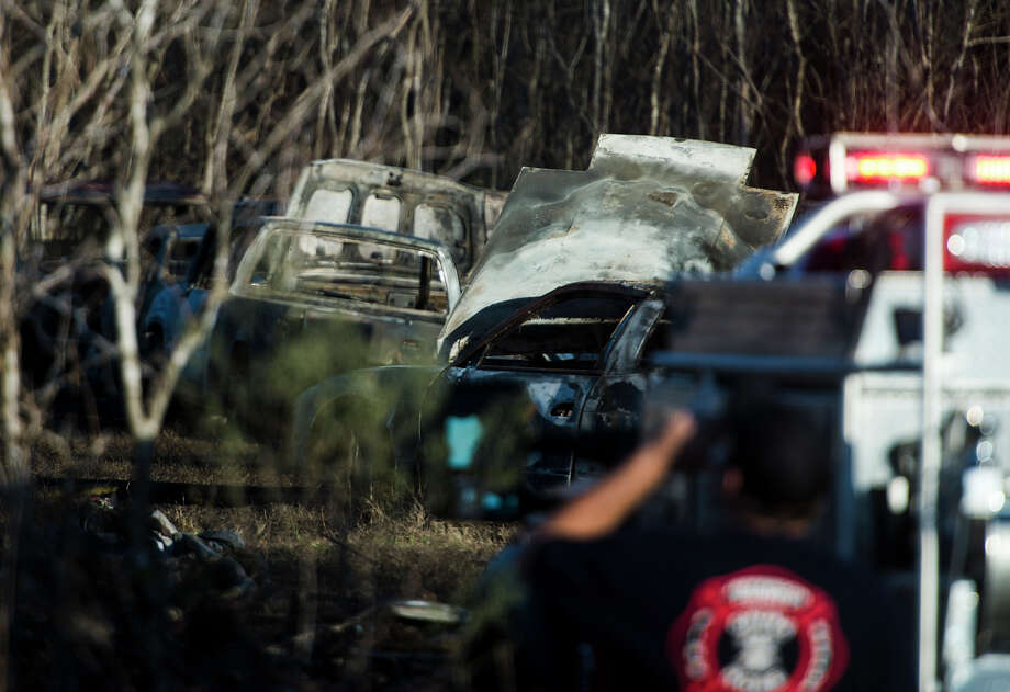 Firefighters from China, Beaumont, and Lumberton responded to a fire off Highway 90 that engulfed 22 vehicles before it was extinguished Thursday afternoon. While no one was injured in the blaze, the cause is still unknown and the event is under investigation. According to China Fire Chief Doug Saunders, three engines, four tankers, and about 30 personnel responded to the fire. Photo taken Thursday, 1/16/14 Jake Daniels/@JakeD_in_SETX Photo: Jake Daniels / ©2013 The Beaumont Enterprise/Jake Daniels