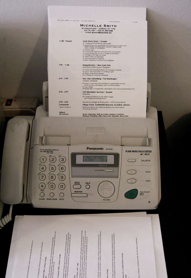Apparently this office hasn't heard of that fancy electronic mail yet. (Sidenote: Did anyone ever use the phone attached to the fax machine?) PHOTO: A fax machine is seen in a New York City office on May 7, 2003. Photo: Chris Hondros, Getty Images / 2003 Getty Images