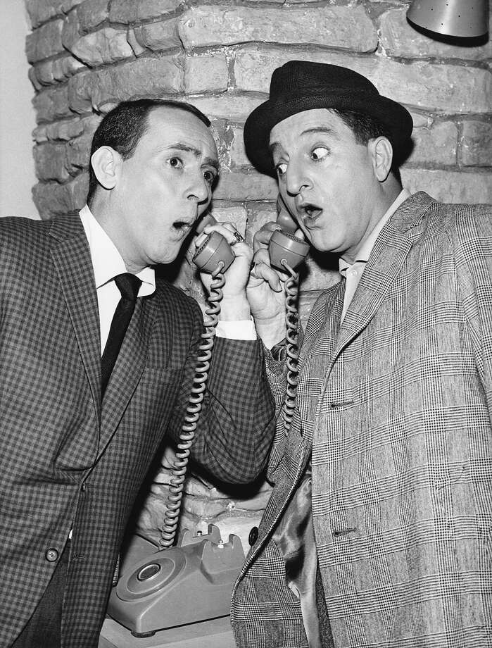 "Why stay at home to call someone when you can do it from a movie theater, library, grocery store or bus?PHOTO: Joey Bishop and Danny Thomas on an episode of ""The Joey Bishop Show."" Photo: Herb Ball, Getty Images / © NBC Universal, Inc."