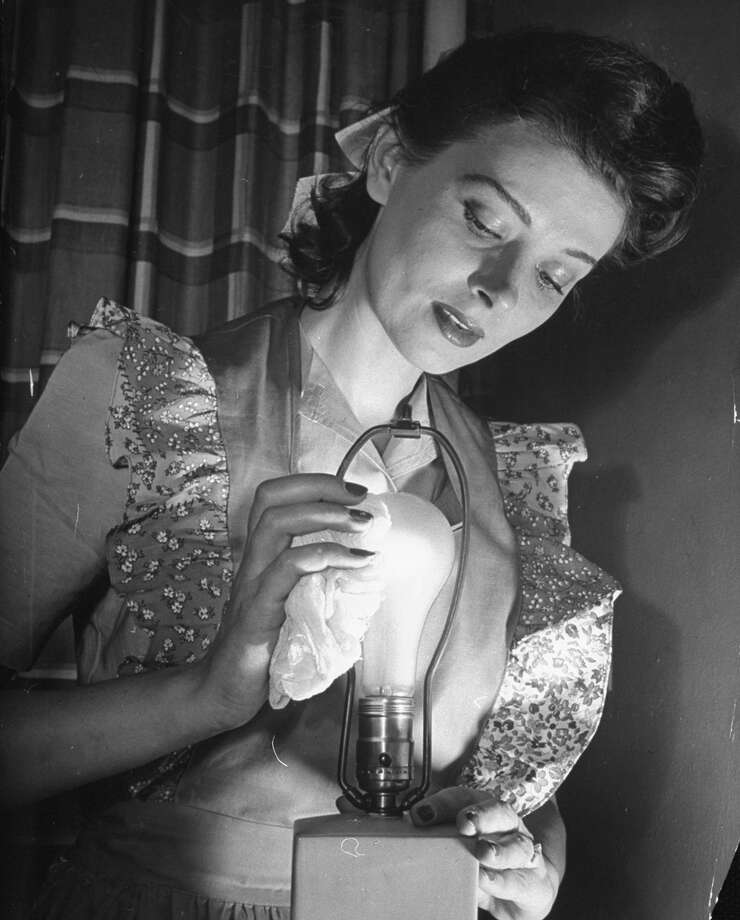 The curly light bulbs are trying to replace these, but haven't quite made it ... yet.PHOTO: This photo, circa 1942, shows how to clean a light bulb. Photo: Nina Leen, Getty Images / Time Life Pictures