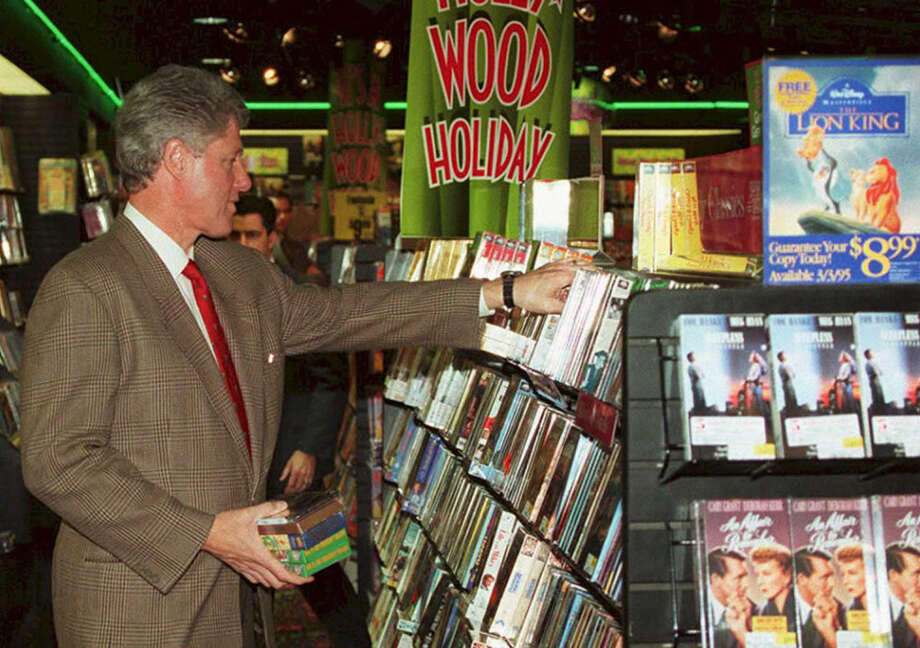 Who needs a video store when you've got Netflix, RedBox, iTunes, Hulu, Amazon Prime ... PHOTO: President Bill Clinton browses in a video store in the Georgetown section of Washington, D.C., on Dec. 23, 1994. Photo: JOSHUA ROBERTS, Getty Images / AFP