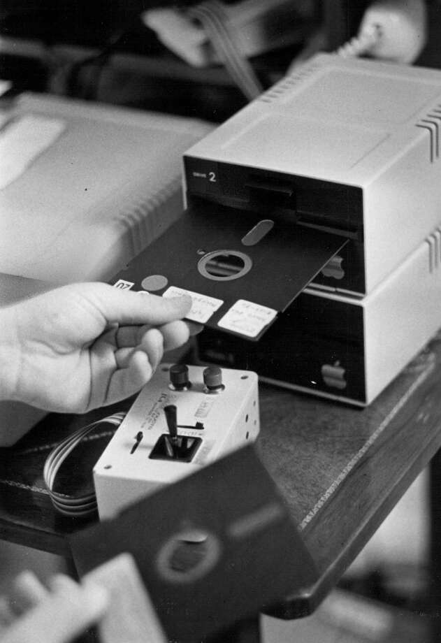 The floppy disk was a key information-storage component ... when this photo was taken in 1982. Photo: Lyn Alweis, Getty Images / (C) 2010 The Denver Post, MediaNews Group