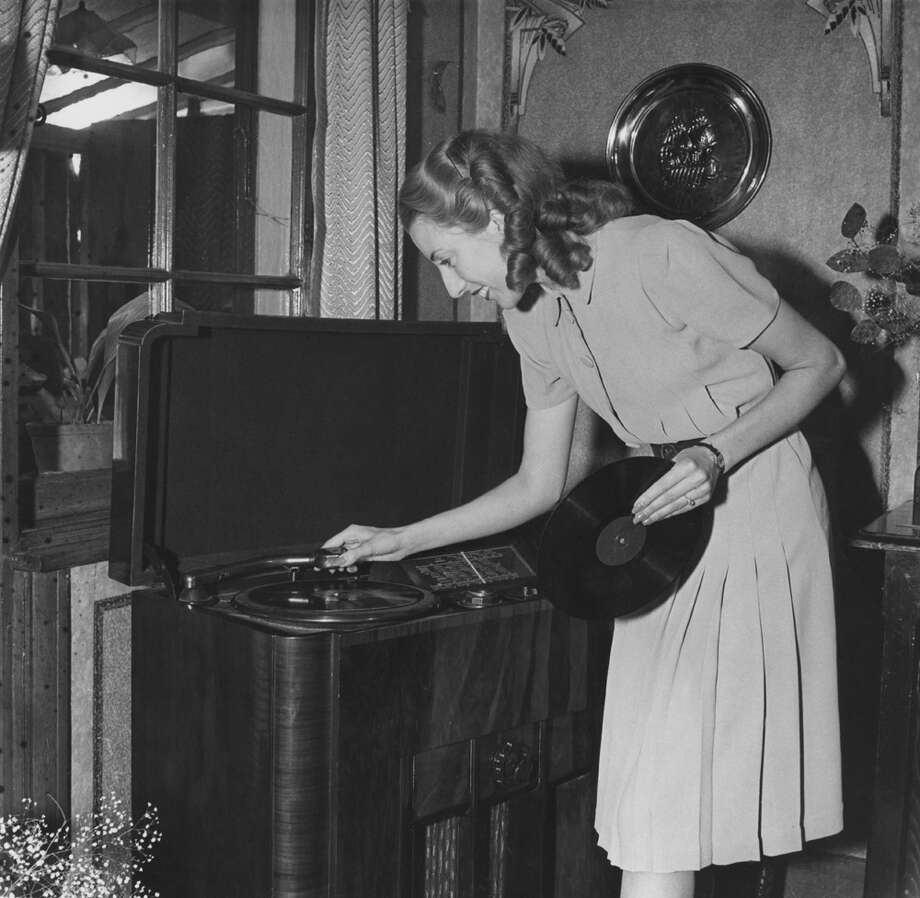 Thanks to hipsters, though, vinyl's been working on a comeback. PHOTO: WWII Forces Sweetheart singer Vera Lynn places a record on her radiogram in England in the 1940s. Photo: Popperfoto, Getty Images / Popperfoto