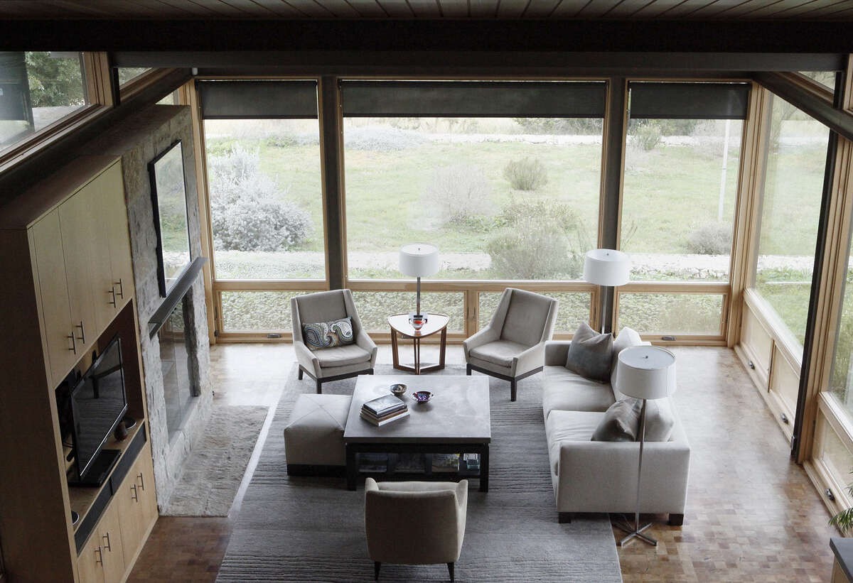 Windows give a home in Leon Springs wide views and lots of light. Mesquite flooring and white oak cabinets are among the sustainable materials used in the LEED Platinum house.
