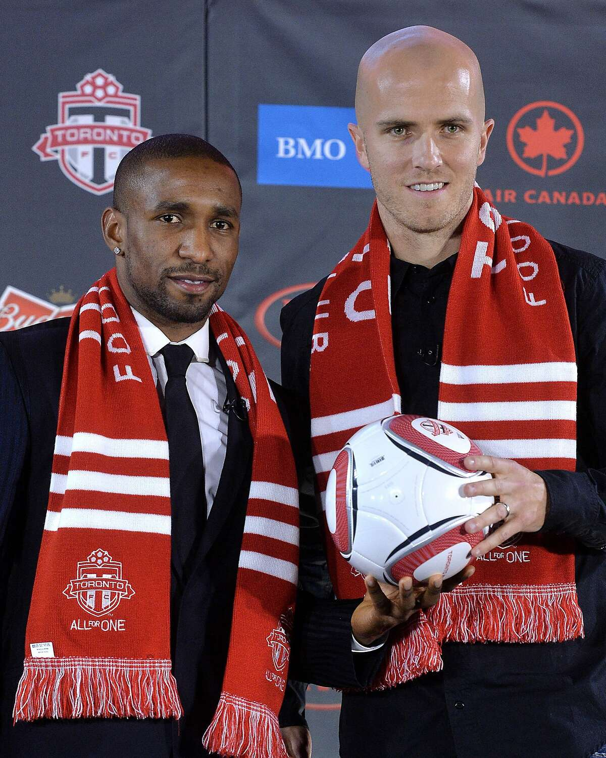 TORONTO, ON - JANUARY 13: Jermain Defoe (L) and Michael Bradley attend a press conference where they were introduced by Toronto FC at Real Sports Bar & Grill on January 13, 2014 in Toronto, Canada. (Photo by Jag Gundu/Getty Images)