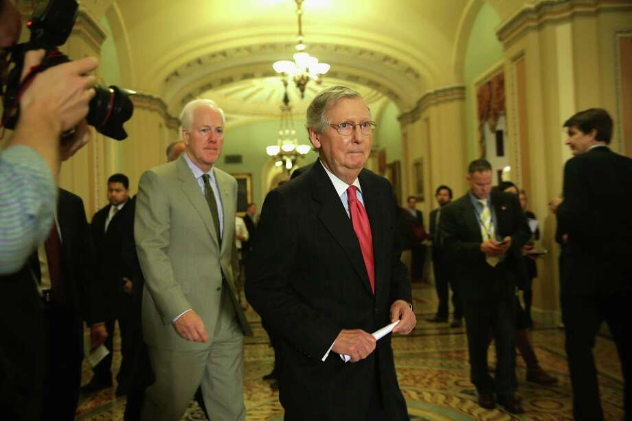 WASHINGTON, DC - JANUARY 14:  U.S. Senate Minority Leader Sen. Mitch McConnell (R-KY) (R) and Senate Minority Whip Sen. John Cornyn (R-TX) (L) approach the podium to talk to members of the media after the weekly Senate Republican Policy Committee luncheon January 14, 2014 on Capitol Hill in Washington, DC. McConnell spoke on the unemployment insurance extension and the omnibus spending bills.  (Photo by Alex Wong/Getty Images) Photo: Alex Wong, Staff / 2014 Getty Images