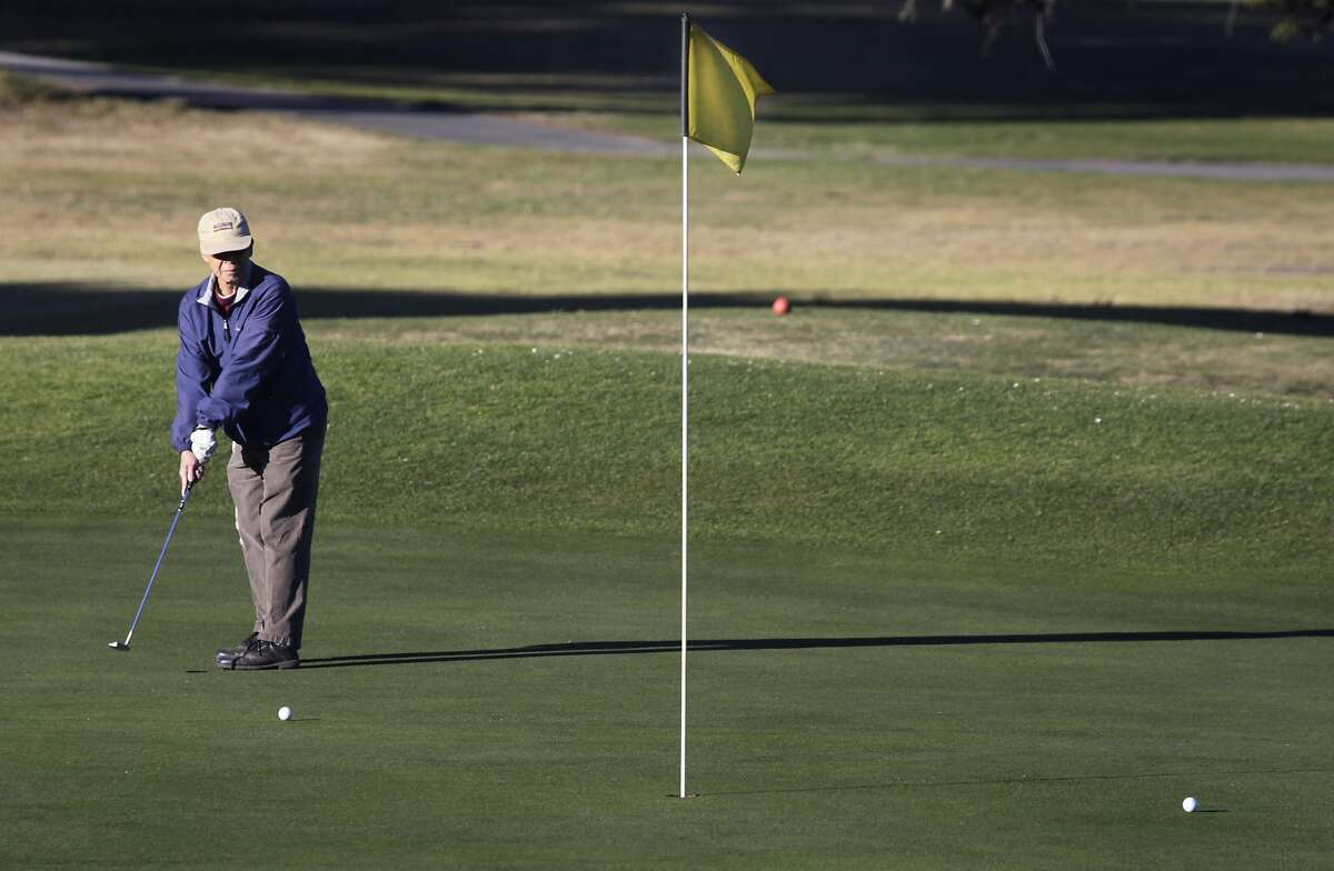 A golfer putts on the 10th green at Sharp Park Golf Course in Pacifica, Calif. on Thursday, Jan. 16, 2014. Proposed improvements to a pump house and a cart path at the San Francisco city owned course worry environmentalists.